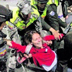 Photo of Manuela Picq being arrested. Photo used with permission.